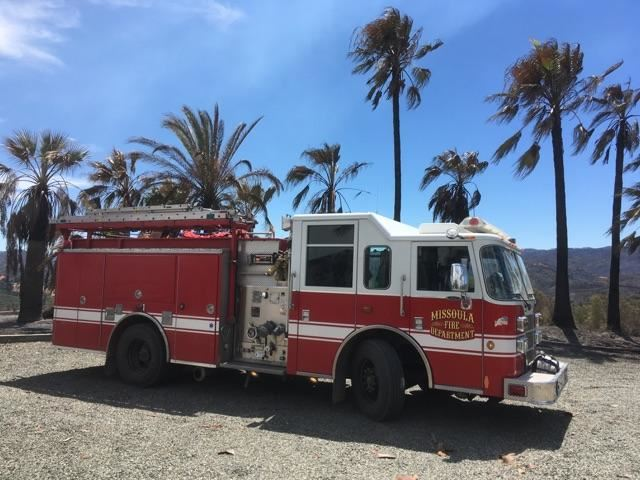 MFD Engine staged in front of palm trees in California.