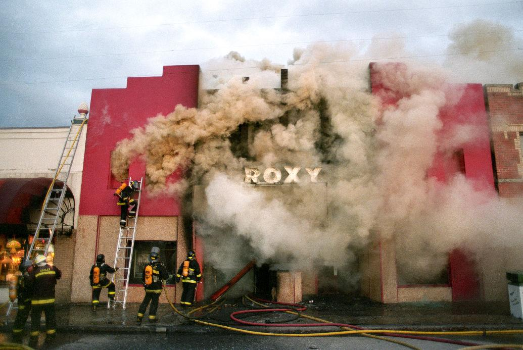Missoula City firefighters battle in vain to douse an arson fire that gutted the historic Roxy Theat